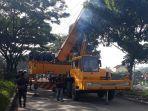 truk-crane-evakuasi-bus-kramat-jati.jpg