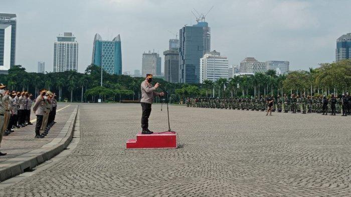 Apel pengamanan Pasar Tanah Abang di kawasan Monas, Gambir, Jakarta Pusat, Minggu (2/5/2021).