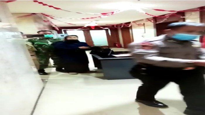 Tangkapan layar seorang wanita membawa bensin menyelinap masuk ke Balai Kota DKI