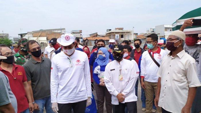 Ratusan Buruh Lepas dan PKL Warga Kampung Pulo Dapat Bantuan Sembako