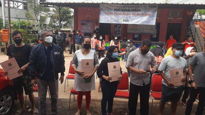Warga Korban Banjir Cipinang Melayu Terima Hasil Restorasi Dokumen Kependudukan