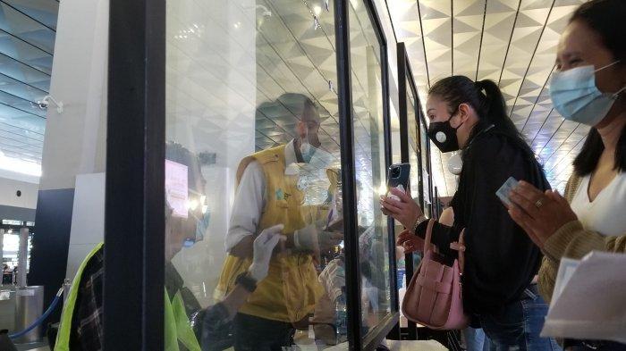 Lokasi validasi kartu bebas Covid-19 di Terminal 3 Bandara Soekarno-Hatta menjelang Libur Natal dan Tahun Baru 2021, Selasa (22/12/2020).