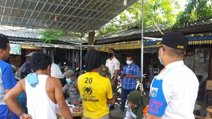 Tak Pakai Masker, Puluhan Orang di Pasar Warakas Kena Sanksi