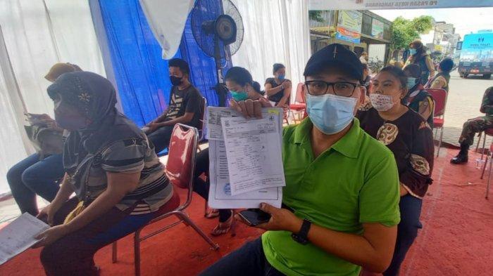 Pemerintah Kota Tangerang melakukan vaksinasi Covid-19 kepada ribuan pedagang pasar di Kota Tangerang pada Senin (1/3/2021).