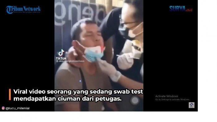 Viral di Media Sosial, Petugas Beratribut Seragam Pemprov DKI Cium Pria yang Mau di Test Swab