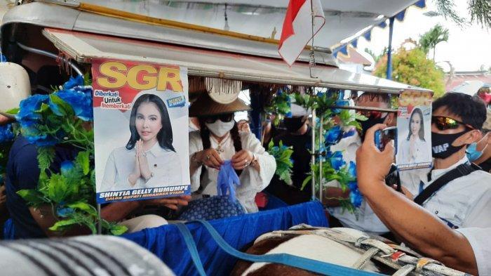 Naik Bendi ke KPU, Shintia Gelly Rumumpe-Netty Agnes Pantow Resmi Daftar Pilkada Minahasa Utara
