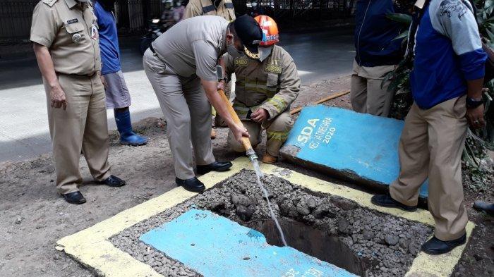 Sumur Resapan di Jalan DI Panjaitan Dicoba, Mampu Serap 2 Ribu Liter Air dalam Waktu 6 Menit