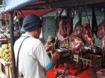 asep-pedagang-daging-yang-berjualan-di-trotoar-depan-pasar-palmerah.jpg