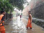banjir-di-jalan-margo-mulyo-halim-perdanakusuma.jpg