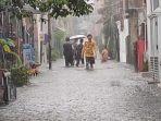 banjir-di-jalan-melur-sukmajaya-kota-depok.jpg