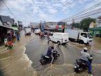 banjir-di-simpang-mampang-depok-2392021.jpg