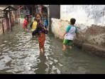 banjir-masih-merendam-pemukiman-warga-di-rt-13-rw-05-kelurahan-cililitan.jpg