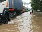 banjir-merendam-cacing.jpg