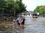 banjir-rob-di-kawasan-pelabuhan-perikanan-samudera-nizam-zachman.jpg