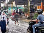 banjir-setinggi-kira-kira-30-sentimeter-melanda-jalan-ks-tubun-1-kelurahan-kota-bambu.jpg