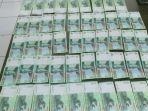 barang-bukti-uang-palsu-pecahan-rp-20000-yang-didapat-dari-tersangka-kls-di-polsek-setu.jpg