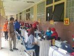 calon-penerima-vaksinasi-covid-19-tangerang-jumat-2622021.jpg