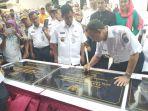 gubernur-dki-jakarta-anies-baswedan-saat-penandatangan-prasasti-di-kelurahan-taman-sari_20180321_185927.jpg