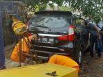 jasad-pria-penuh-luka-tembak-ditemukan-di-dalam-mobil-purwakarta-kamis-682020.jpg