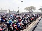 lokasi-lahan-parkir-kendaraan-roda-dua-gedung-tod-yang-dapat-menampung-sekira-6000-unit-motor_20180316_130245.jpg