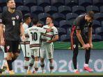 para-pemain-timnas-portugal-merayakan-gol-yang-diciptakan-oleh-diogo-jota.jpg