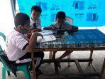 pelajar-yang-mengikuti-pjj-di-tenda-wifi-gratis-selasa-1182020.jpg