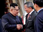 pemimpin-korea-utara-kim-jong-un-tiba-di-bandara-changi-singapura_20180610_153827.jpg