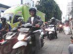 pengendara-sepeda-motor-melintasi-jalur-sepeda.jpg