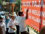 penunggak-pajak_20181024_091424.jpg