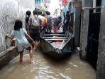 permukiman-warga-rw-07-bidara-cina-terdapak-banjir.jpg