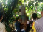 petugas-bersama-warga-sekitar-mengevakuasi-jasad-korban-dari-atas-pohon-rambutan.jpg