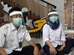 petugas-medis-puskesmas-kelurahan-malaka-sari-saat-mengenakan-face-shiel.jpg