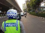 polisi-ganjil-genap-pancoran_20180718_110925.jpg