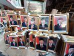 sejumlah-foto-bergambar-presiden-joko-widodo-dan-wakil-presiden-maruf-amin.jpg