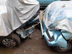 taksi-yang-diamankan-jadi-barang-bukti-kasus-kecelakaan-di-kantor.jpg