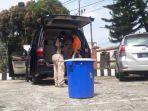 tim-inafis-dari-polres-subang-kasus-temuan-jasad-ibu-dan-anak-di-bagasi-mobil.jpg