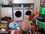 tumpukan-pakaian-milik-pelanggan-di-laundry.jpg