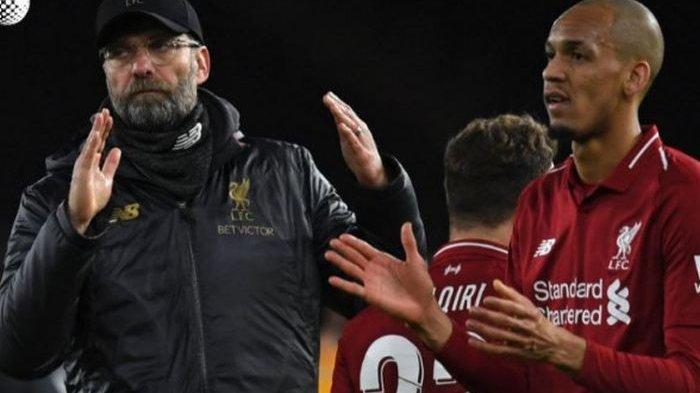 Reaksi pelatih Liverpool, Juergen Klopp (kiri), dan gelandang Fabinho