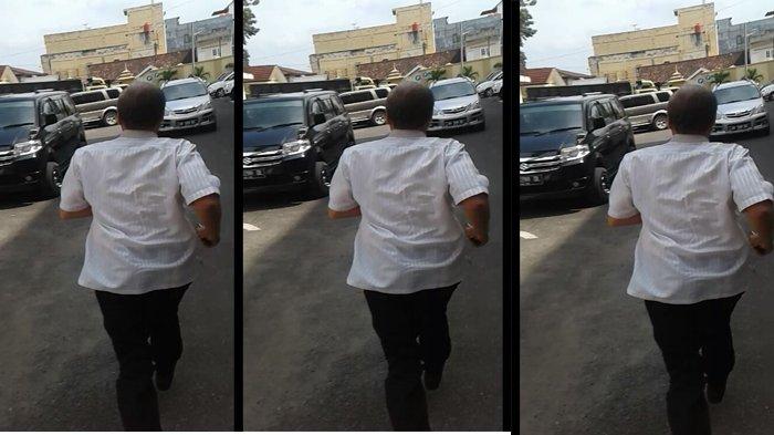 Usai Diperiksa KPK, Kepala Dinas Pariwisata Provinsi Jambi Berlari Menghindari Wartawan.