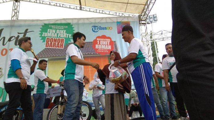 Alami Kecelakaan Tunggal, Samad dan Isteri Tetap Semangat Ikuti Jalan Sehat Tribun Jambi ke 9