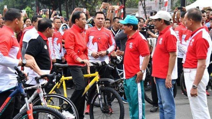 Terungkap, Ternyata ini Alasan Jokowi Suka Bagi-bagi Sepeda Selama Menjabat Sebagai Presiden