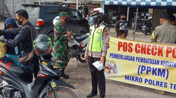 Anggota Pos PPKM Polres Tebo Jaring Pengendara Tak Pakai Masker