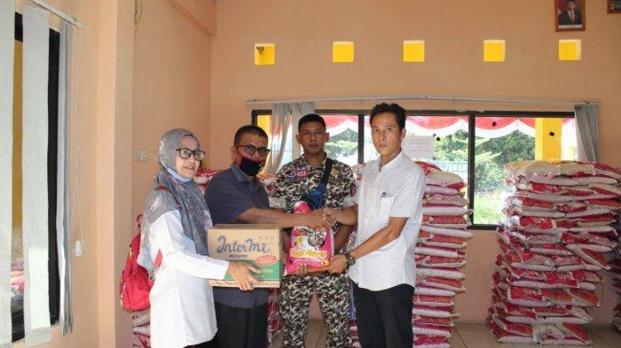 Dinsos Sarolangun Salurkan Bantuan 2.552 KK Korban Banjir Pauh dan Mandiangin