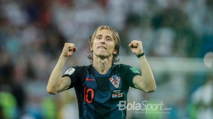 Ekspresi gelandang dan kapten Kroasia, Luka Modric,, setelah timnya lolos ke final Piala Dunia 2018 dan mengalahkan Inggris di Stadion Luzhniki, Kamis (12/7/2018)