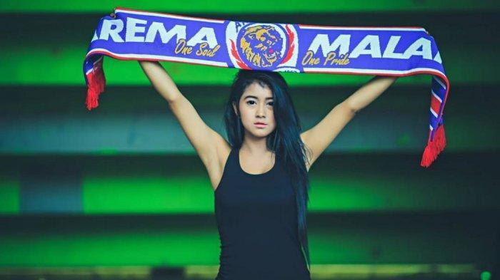Pendukung Arema FC, Arema Malang.