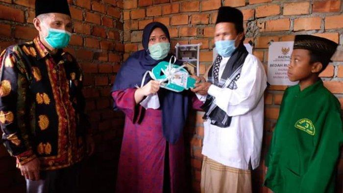 Anwar Bahagia Dapat Rumah Melalui Bantuan dari Baznas Muarojambi