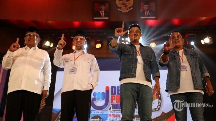 Pasangan Calon Wali Kota dan Wakil Wali Kota Medan nomor urut satu, Akhyar Nasution-Salman Alfarisi (kiri) dan pasangan nomor urut dua, Bobby Nasution-Aulia Rahman (kanan) Sabtu (5/12/2020) malam.