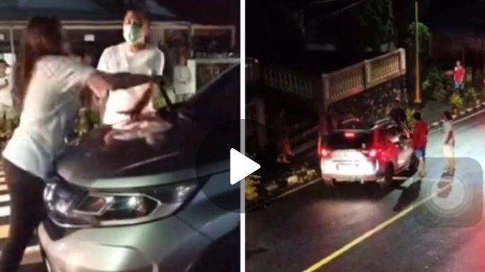 Sepasang suami istri berdebat di jalan karena selingkuhan.