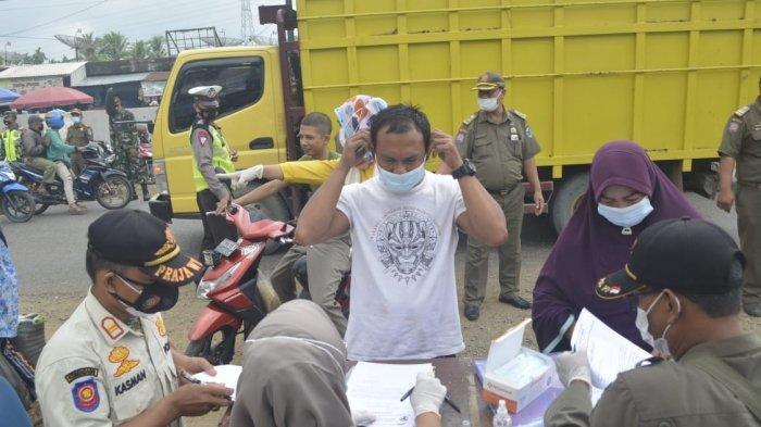 77 Orang Tak Pakai Masker Terjaring Operasi Yustisi di Pasar Tembesi, Petugas Berikan Hukuman Fisik