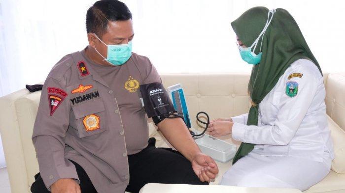 Wakapolda Jambi Brigjen Pol Yudawan Roswinarso hari ini melaksanakan Vaksinasi Covid-19 Tahap II